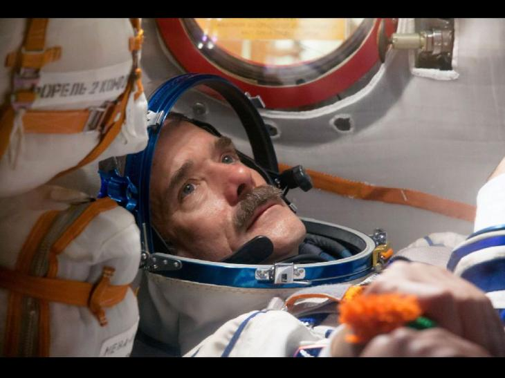Chris Hadfield doing pre-launch check in Soyuz rocket