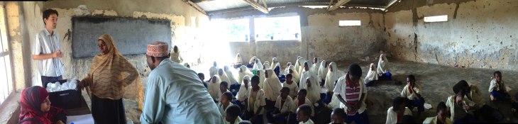 Schoolchildren in rural Tanzania involved with iphone-microscope testing ~ I Bogoch