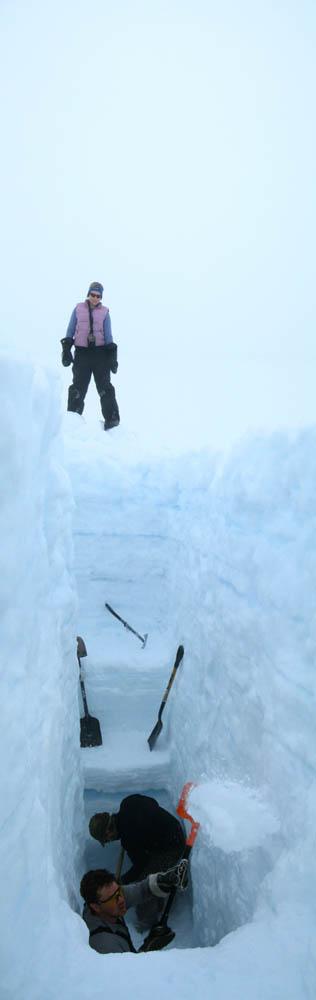 Digging a four-meter snow pit into snow layers of the Devon Island Ice Cap, Nunavut ~ Alex Gardner