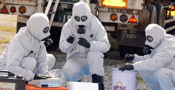 Biosecurity team hunting for pathogens . PHOTO: STR/AFP/GETTY IMAGES)