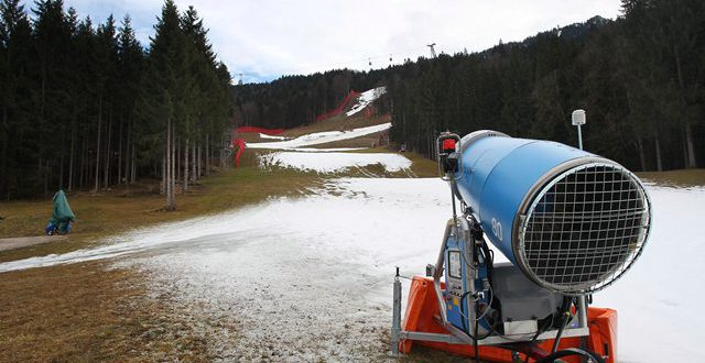 A snow gun stands on the periphery of the Kandahar ski slope, which is only fragmentarily covered with snow, in Garmisch-Partenkirchen, Germany on Jan. 13, 2014. The women's alpine skiing World Cup, which was scheduled for the end of January, had to be called off because of the lack of snow. PHOTO: KARL-JOSEF HILDENBRAND/AP