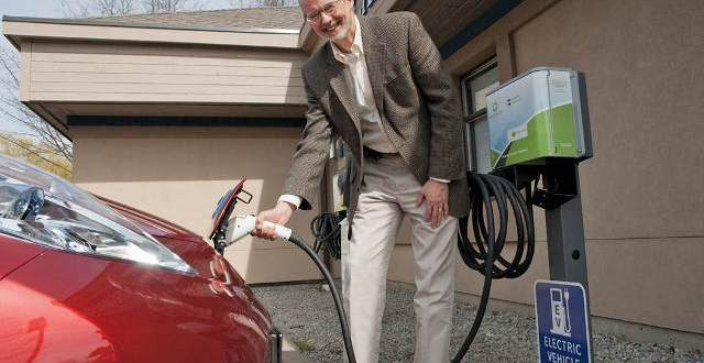Tom Pedersen, executive director of the Pacific Institute for Climate Solutions at the University of Victoria in B.C., plugs in his electric car in Victoria. PHOTO: MATT KELLEY
