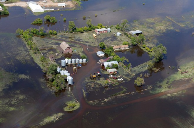 Floodwaters inundate a farmstead near Gainsborough, Sask.  ~ CP Don Healy
