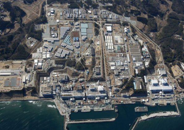 Aerial view of tsunami-ravaged Fukushima Dai-ichi nuclear power plant in Fukushima Prefecture, northeastern Japan ~ AP PHOTO/KYODO NEWS