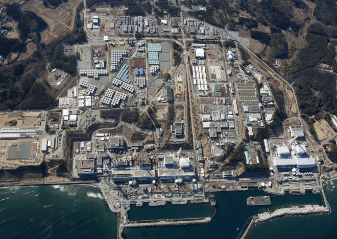 Aerial view of tsunami-ravaged Fukushima Dai-ichi nuclear power plant in Fukushima Prefecture, northeastern Japan ~ AP PHOTO/KYODO NEWS