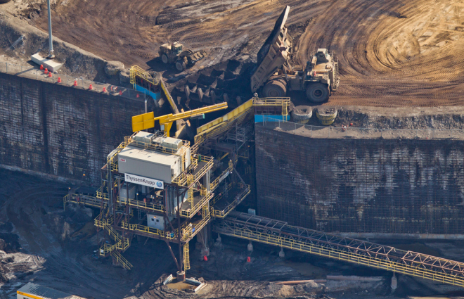 Rruck dumping oilsands into a hopper at Suncor's base plant oilsands upgrading facility north of Fort McMurray, Alta.  ~ RYAN JACKSON / EDMONTON JOURNAL