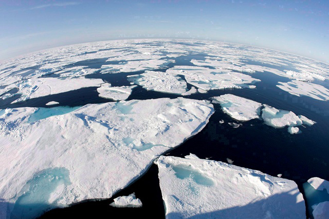 Ice floes float in Baffin Bay above the Arctic circle as seen from the Canadian Coast Guard icebreaker Louis S. St-Laurent on July 10, 2008. ~ JONATHAN HAYWARD CP
